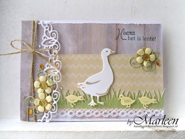 Handmade card by DT member Marleen with Creatables Curved Border (LR0396), Mother Goose (LR0410), Craftables Grass (CR1355) and Flower Set Fancy (CR1356) from Marianne Design