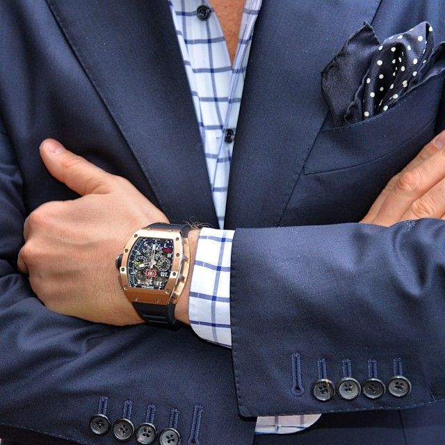 blue suiting with a Richard Mille watch on wrist