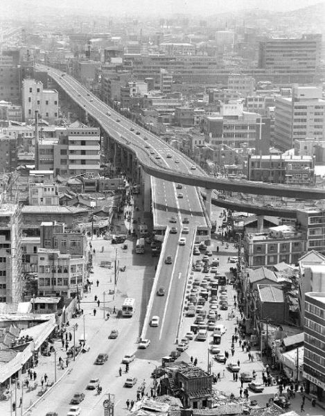 Seoul: Cheonggyecheon elevated highway in downtown Seoul, 1969 청계천 (淸溪川).  Constructed between 1958 and 1976 this was a 5.6 kilometer long elevated highway through the center of Seoul.  It was razed between 2003 - 2005 to reveal the underlying Gacheon stream and provide a beautiful riverwalk in the center of Seoul.