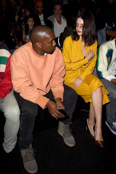 Kanye West wearing Acne Studios Ace Used Cash Slim-Fit Jeans, Yeezy Boost 750 Light Grey/Gum, Yeezy Tour Donda West and Robert Kardashian T-Shirt and Yeezy Season 3 Sweatshirt