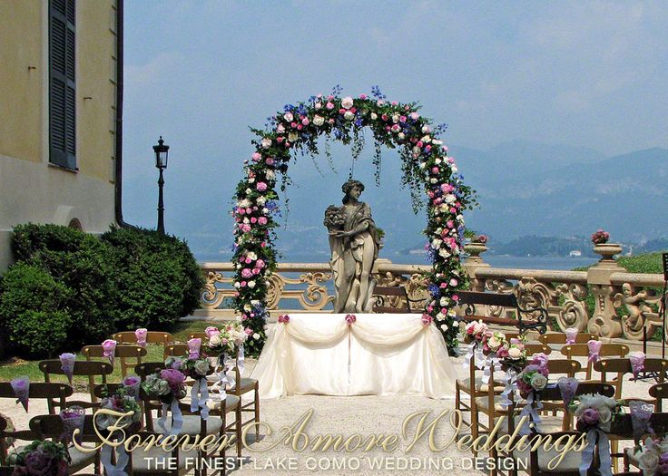 Lake Como weddings. Beautiful ceremony at Villa Balbianello, Terrace Canfora. Giant flower arch in the shades of ivory, pink and lavender. Picture by ForeverAmoreWeddings ©