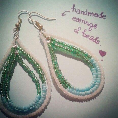 Handmade earrings of emerald - turquoise - milky beads..