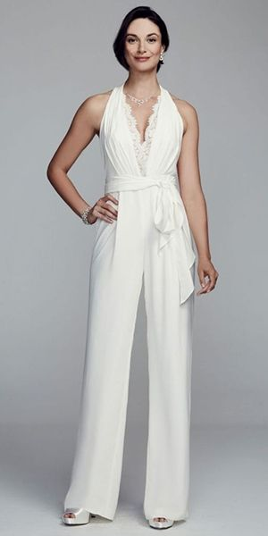 Halter crepe wedding jumpsuit by DB Studio featuring a lace trim deep v-neckline with lace back / http://www.deerpearlflowers.com/wedding-pantsuits-and-jumpsuits-for-brides/
