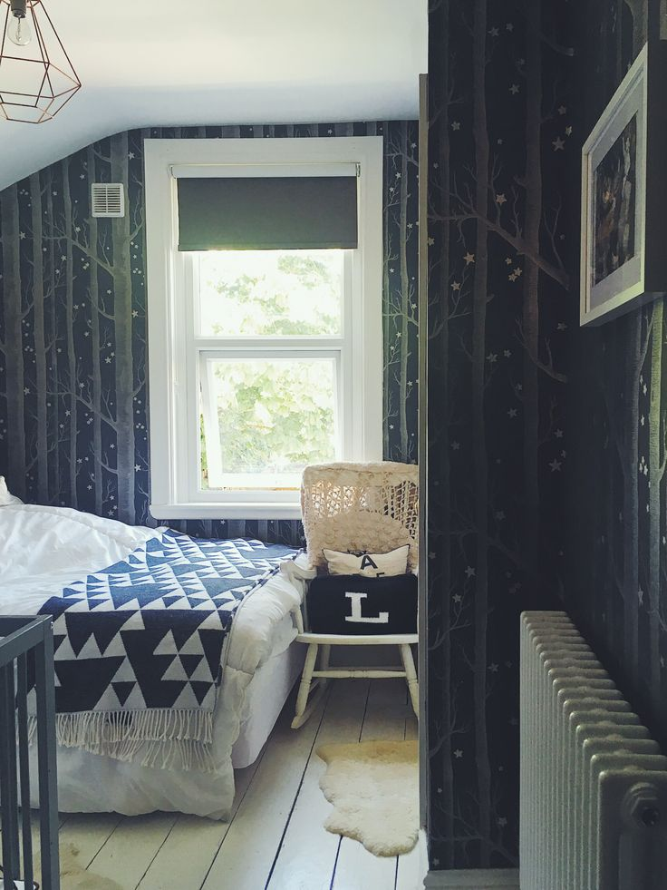 Cosy guest bedroom with Cole and Son wallpaper Woods and