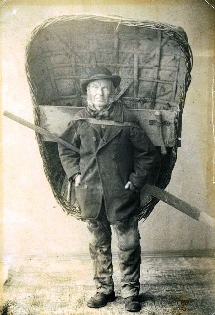 A Welsh fisherman carrying a coracle.