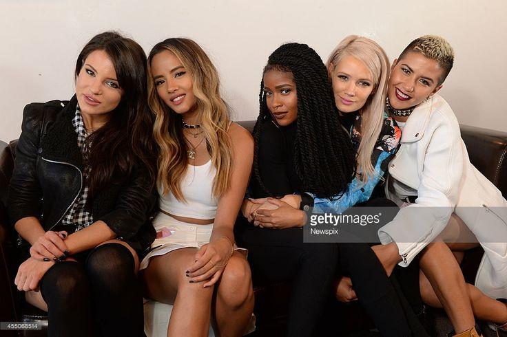 Natasha Slayton, Emmalyn Estrada, Simone Battle, Lauren Bennett and Paula van Oppen of girl group 'G.R.L.' pose during a photo shoot on August 15, 2014 in Melbourne, Australia.