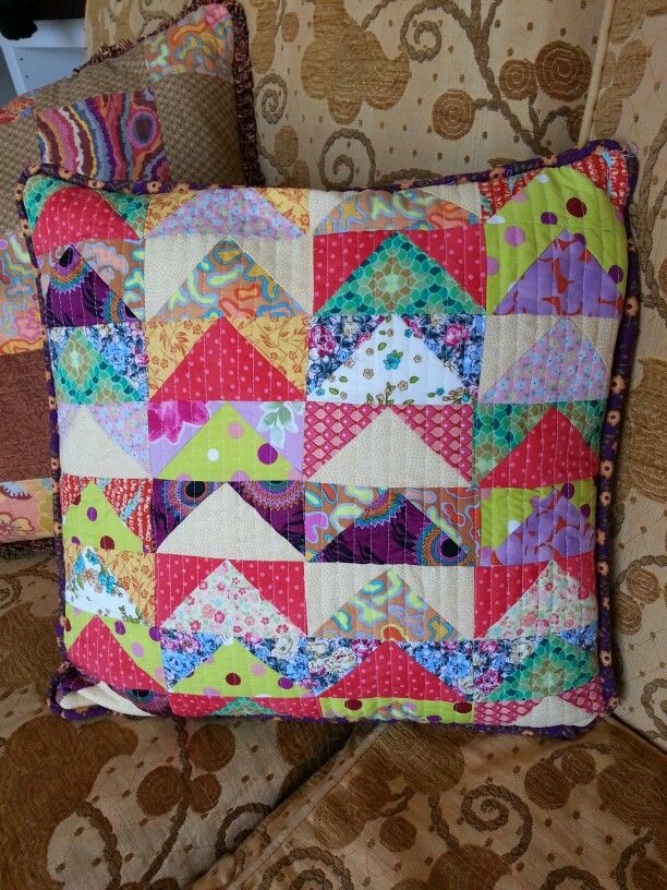 Multicoloured flying geese cushion