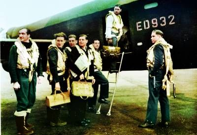 The crew board their Avro Lancaster, ED932/G, for the Dams raid. Left to right: Flight Lieutenant R D Trevor-Roper DEM; Sergeant J Pulford; Flight Sergeant G A Deering RCAF; Pilot Officer F M Spafford DFM RAAF; Flight Lieutenant R E G Hutchison DFC; Wing Commander Guy Gibson; Pilot Officer H T Taerum RCAF.