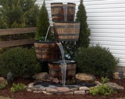 Look at this beautiful piece of craftsmanship. This fountain is made from 2 of our Kentucky whiskey barrels cut in half. Perfectly landscaped, a true piece of art.