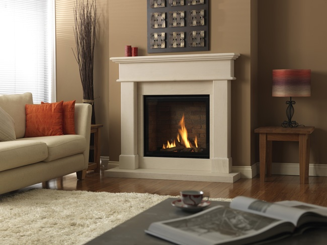 Dru fireplaces: The Grace gas fire suite combines the impressive Global 70XT gas fire with a classic, solid limestone fire surround.