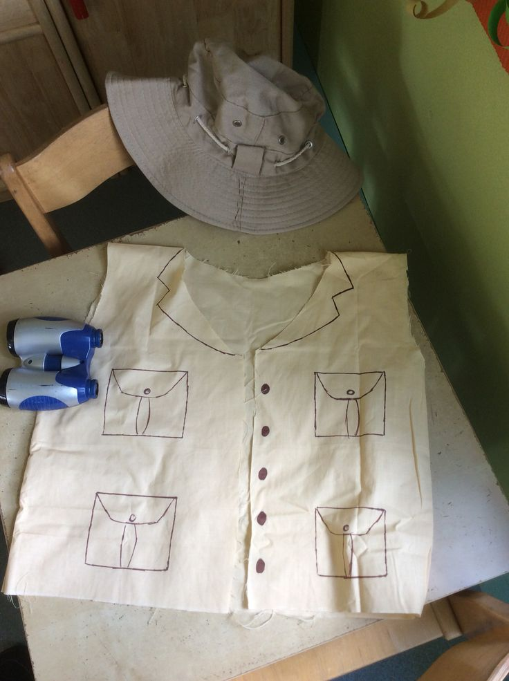 jungle explorer outfits for pre school role play made from a beige pillow case and a sharpie pen, with binoculars and hat from Amazon!
