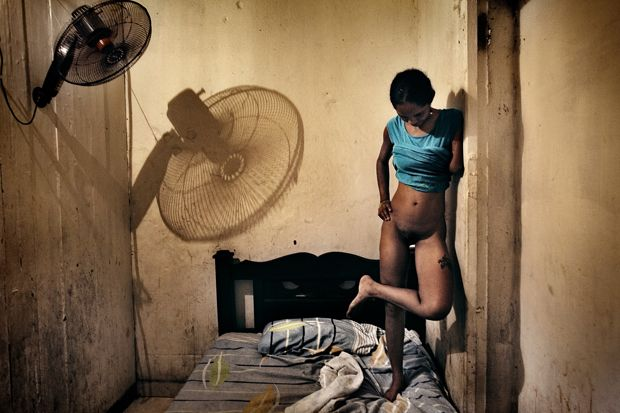 Inés, a 17-year-old addict prostitute, is waiting for the next client (Cartagena, Colombia; August 2011). Inés had been a prostitute since she was 11, using money to feed her daughter and to buy crack and Paco doses. Her left forearm was cut off by another prostitute as a revenge. This doesn't discourage clients often ask specifically for the 'armless whore'.