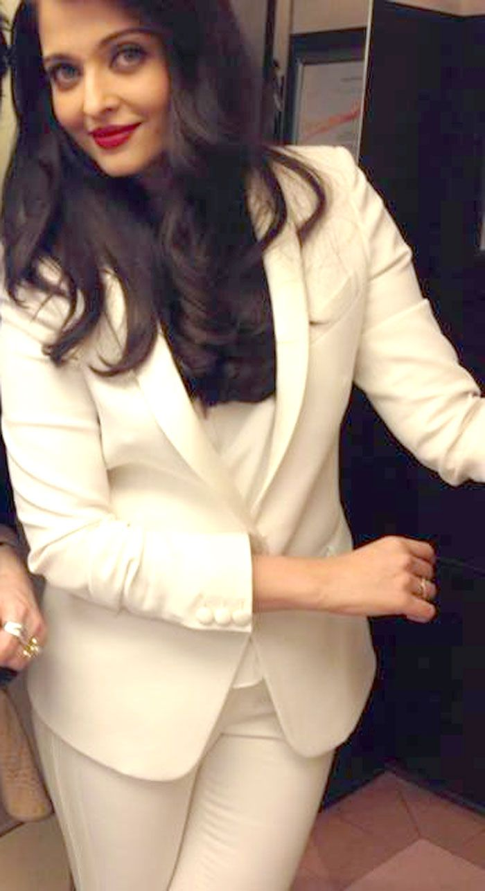 Aishwarya Rai Bachchan looked stunning in a white business suit with red lips. #Style #Bollywood #Fashion #Beauty #Cannes2014