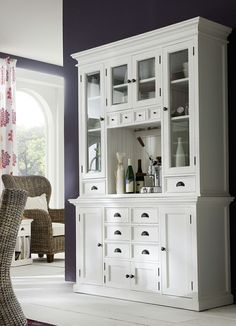 Modernize your living space with this NovaSolo wood hutch. This white hutch unit is an ideal piece for your home furnishing collection. The sturdy wood frame and modern brass and glass accents, make i