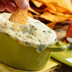 Blue Cheese Bacon Dip (7 bacon slices, chopped  2 garlic cloves, chopped  2 (8-ounces) cream cheese, softened  1/3 cup half-and-half  4 ounces blue cheese  2 tablespoons chopped chives  3 tablespoons chopped walnuts, toasted) by elma