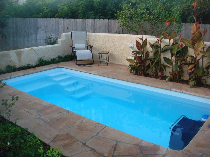 Fiberglass Swimming Pool Designs hz e 1a Interesting Fiberglass Swimming Pools Existence Inspiring Fiberglass Swimming Pool With Grey Colored Simple Chair And Several Plant Decorat