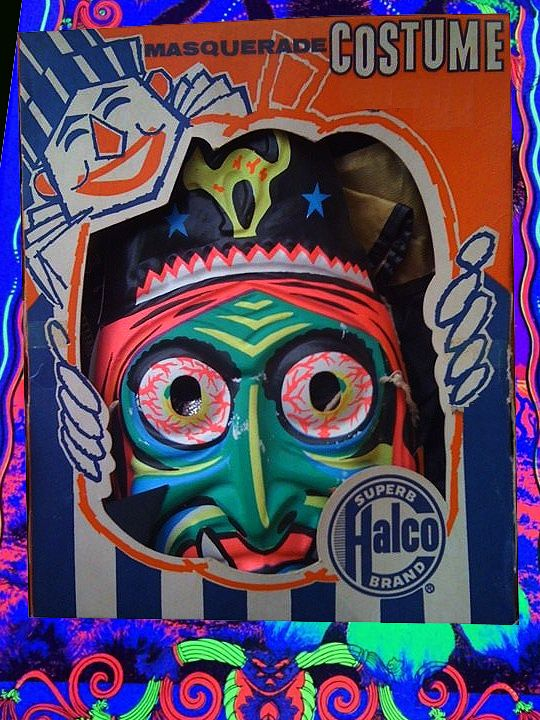 Vintage 1950s Halco brand Witch Halloween Costume with bloodshot eyes that would make Rat Fink proud. Presented in a blacklight Fun House kind of atmosphere.