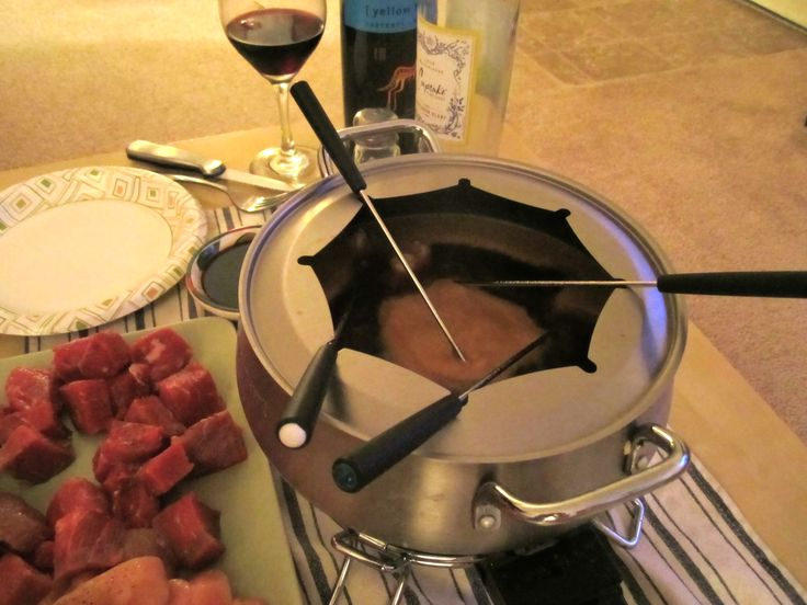 Coq Au Vin Fondue - dippers: shrimp, chicken, filet, potatoes, mushrooms, squash
