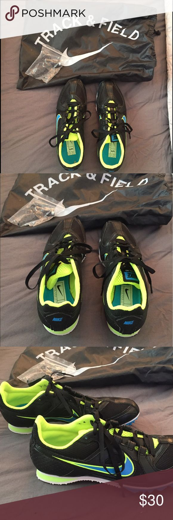 NIKE Rival Md track and field spikes PERFECT NEVER WORN Nike track and field spikes! Comes with spike changer and in storage bag. Black base color with neon yellow and blue accent colors. Multi use spikes- for distance or sprinting and can be manipulated by changing the spikes for your particular use! Nike Shoes Athletic Shoes