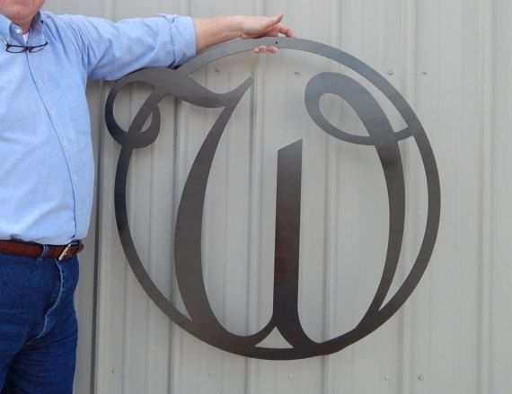 """36 Front Door Circle with Monogram Letter Front Door Circle can be hung on a door, wall, or add to a grouping in your home for added décor. This Art Sign can be used indoor or outdoor. This is great to add on your front door adding a special and inviting touch to your home. For lower case letters please convo us. DIMENSIONS: Measures approximately: 36"""" High x 36 Wide DETAILS: Quality 14 Gauge Steel (about the thickness of a nickel) Made in Tennessee by Tennessee Craftsman! For indoor or o..."""