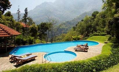 Swimming pool with valley view at The Kurumba Village Resort, Tamil Nadu, India