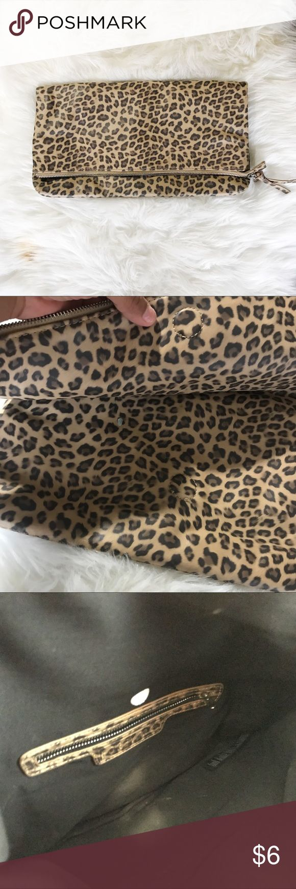 Leopard Clutch Has small green dot of paint inside when you close it, you cant tell only when you open it. Inside is a little dirty but I've had it for years and its still in good condition!! Forever 21 Bags Clutches & Wristlets