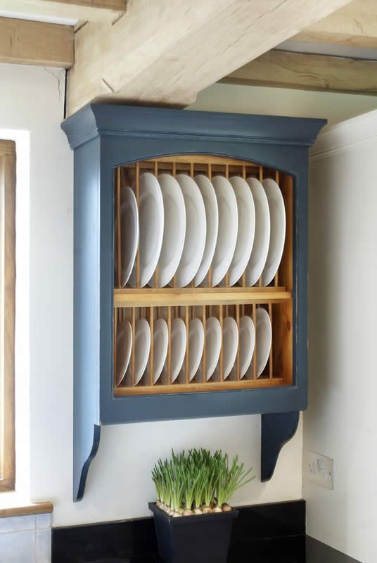 Plate racks. See more at http://woodworkkitchens.co.uk/kitchens/kitchen-details/