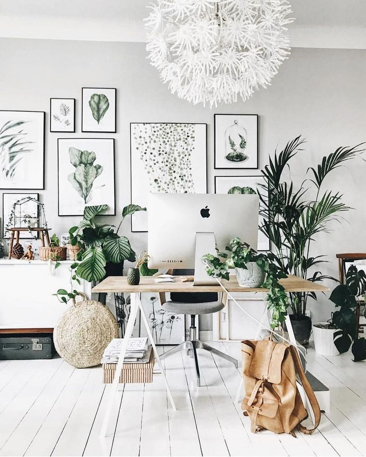 A Beautiful Modern Home Office With Plants And A Cute Fram Wall