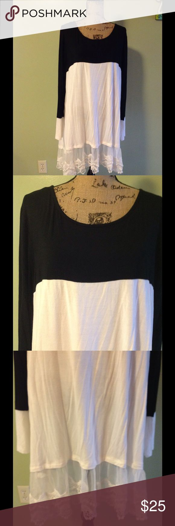 Reborn J tunic dress 3X Reborn J tunic 3X. Could be worn as a dress. It is white with black at the top. It has white lace material at the bottom. Long sleeve. I don't know the material but it's very soft and stretchy. Good condition Reborn J Tops Tunics