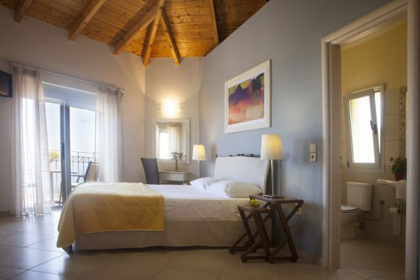 Upstairs the bright, attractive bedrooms feature high, exposed pine beamed ceilings, en-suite bath or shower rooms and private balconies or a terrace with stunning sea views.