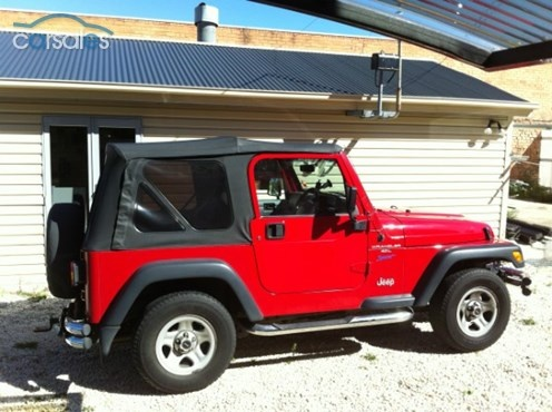 OLD, RED JEEP WRANGLER 1998. Needs a serious lift and a bad A winch