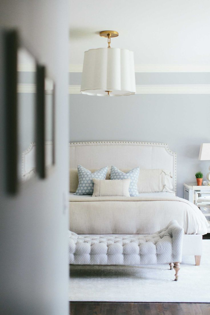 Neutral bedroom with touches of blue.