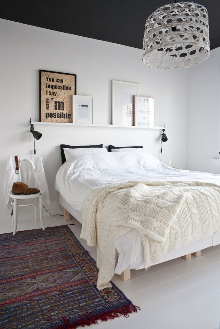 Inside the home of Fluer & Nick | Scandinavian with a boho twist | the usual white walls and bed, white chair as a nightstand, dark gray ceiling (an interesting twist) plus the rest of the house is amazing | via the Dutch blog Interior Junkie