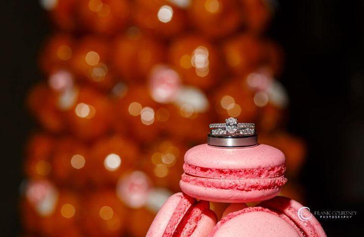 Wedding rings displayed on the cake