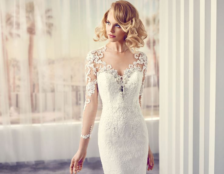 Modeca Suki design from LePapillion collection. Elegant lace sleeve sweetheart bodice design. Future hugging mermaid gown with lace train.