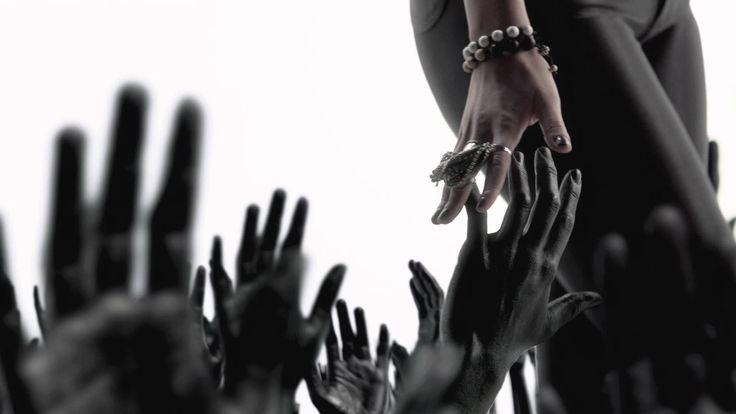 DEV - In The Dark.  i love DEV naked and the black arms