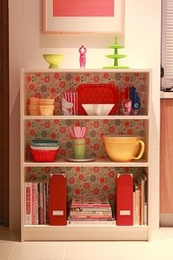 Amazing how a little wallpaper or contact paper can give any ole bookshelf character!