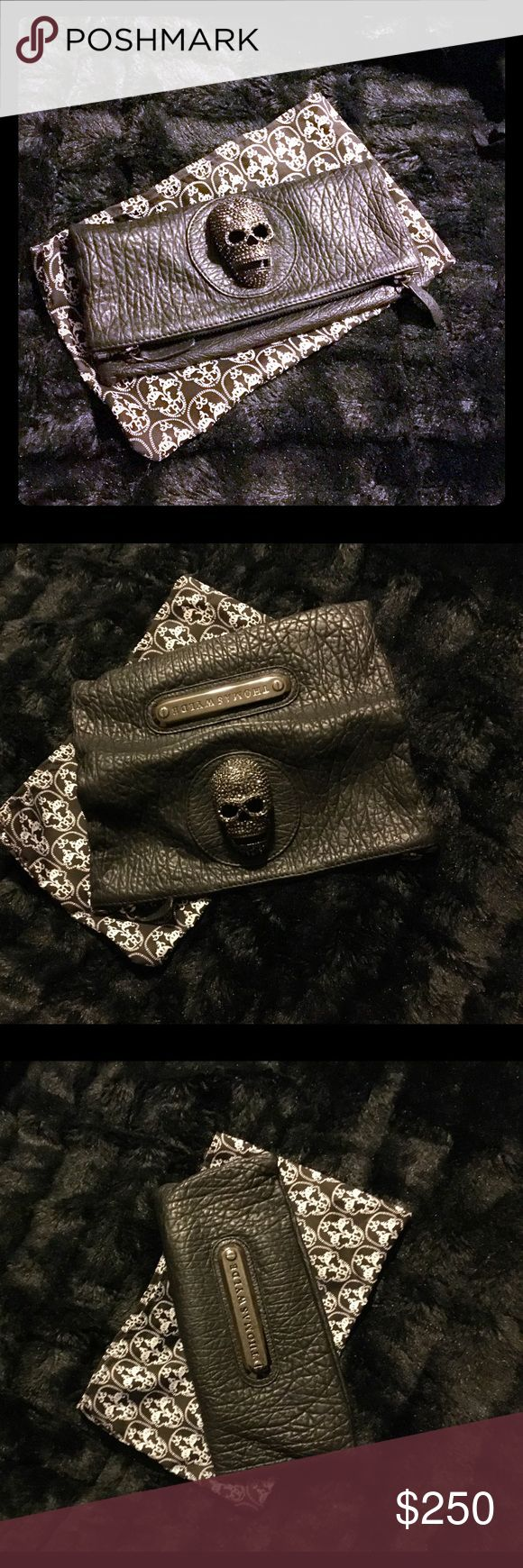 Original Thomas Wylde clutch and rhinestone skull! This is a never used designer piece. Thomas Wylde, heavy distressed leather with a huge malachite rhinestone skull. Bag includes original dust cover. Wild couture statement piece for cocktail party, runk, rock, goth, heavy metal, hipster rock n roll looks! Thomas Wylde Bags Clutches & Wristlets