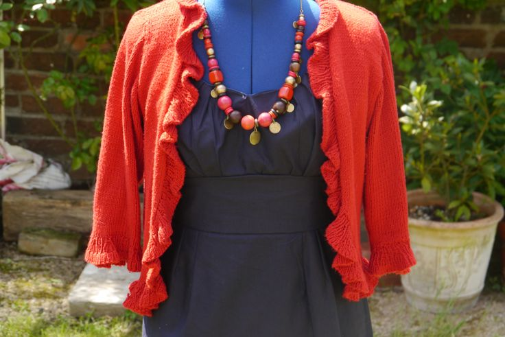 The V8555 in navy cotton with a handknitted cardigan in red...