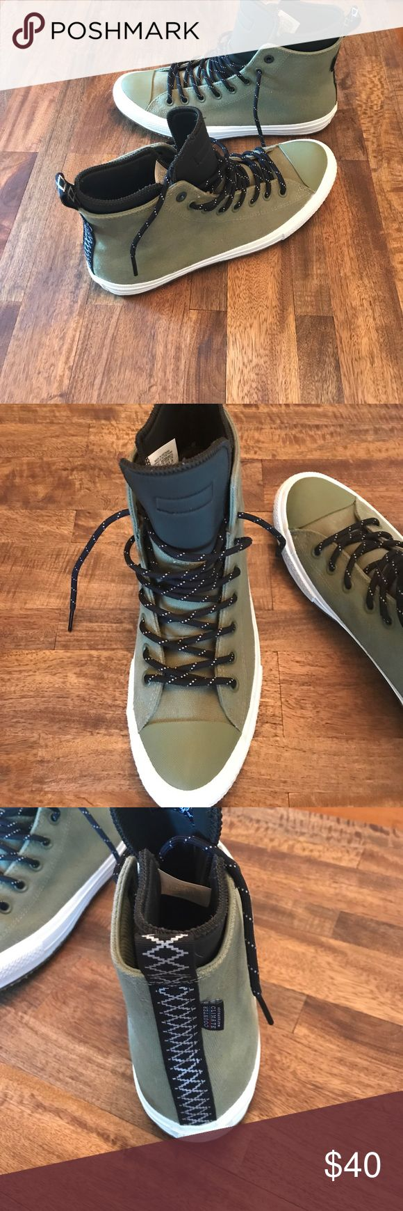 Men's Converse Chuck Taylor high tops green Wore these shoes two times maybe, just didn't dig the new take on an old design. Waterproof!  Size 10.5 mens Converse Shoes Sneakers