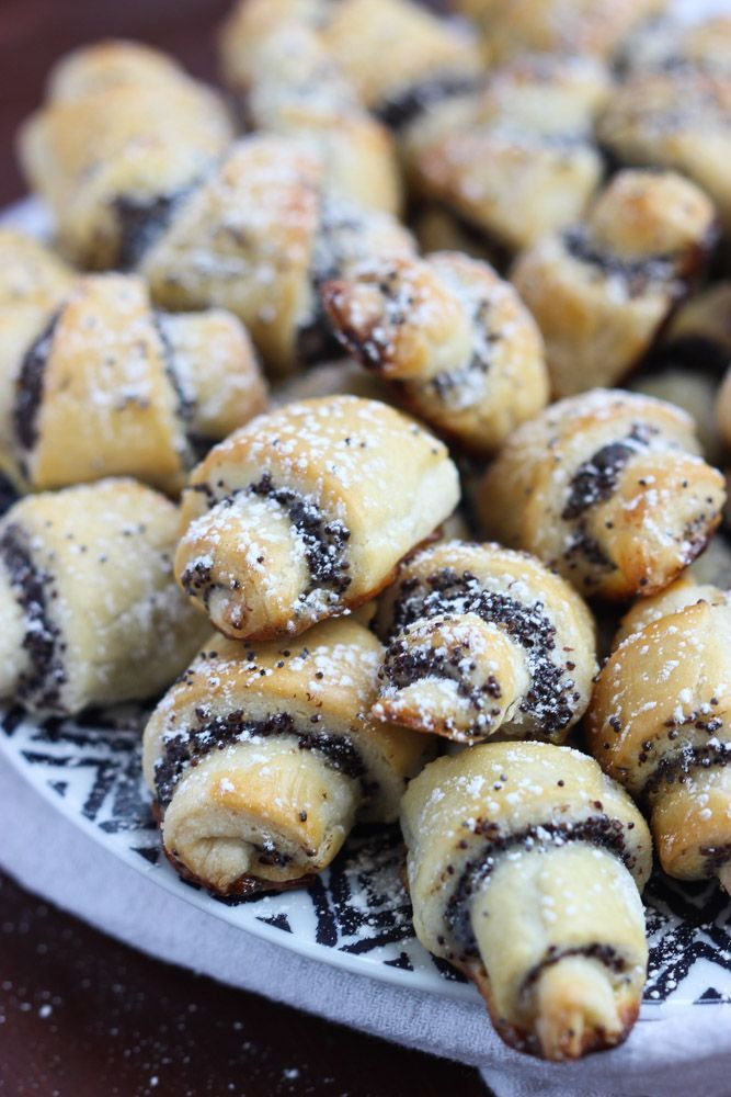 Soft little rugelach cookies with the most tastiest homemade poppy seed filling. Dusted with powdered sugar for extra sweetness. Perfect for Christmas brunch.