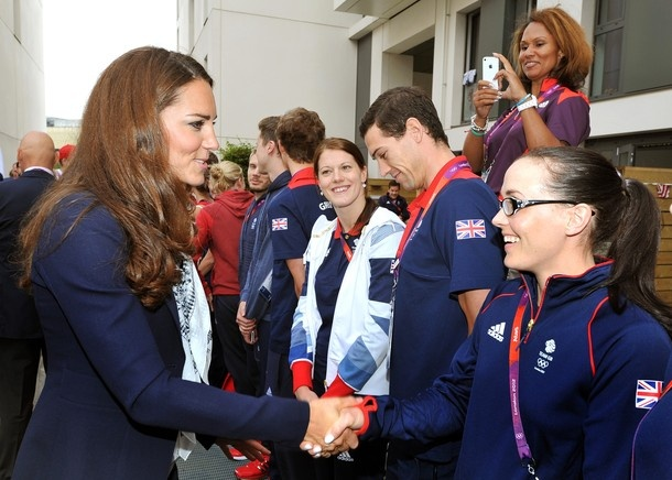 Catherine, Duchess of Cambridge, shakes hands with Great Britain cyclist Victoria Pendleton (R) during a visit to team GB accommodation flats in the Athletes Village at the Olympic Park in Stratford, east London, on July 31, 2012.
