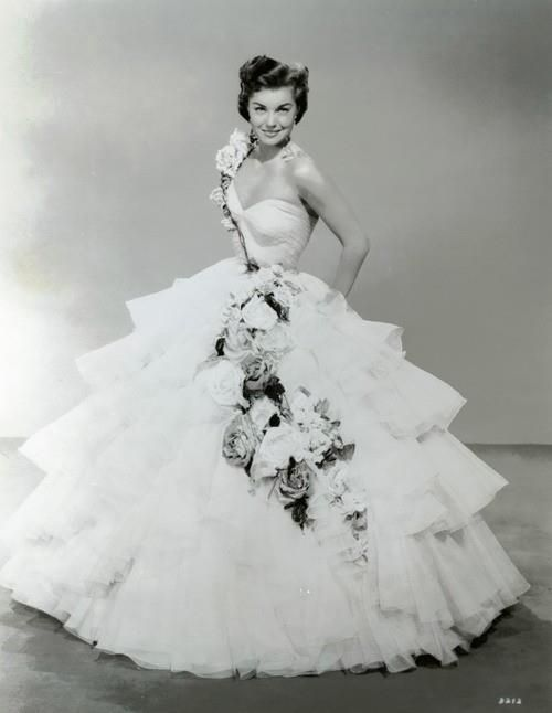 1950s vintage wedding dress. Maybe without the flowers. I love the fit of the top.