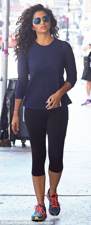 Blue belle: Camila Alves stunned in a low-cut blue dress in New York City after hitting the gym in a navy blue peplum top