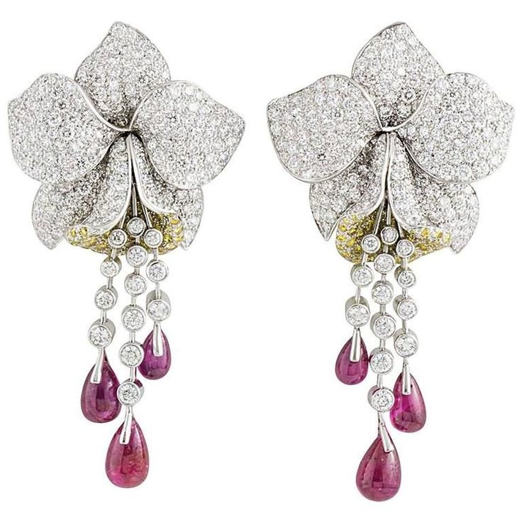 Cartier Caresse d'Orchidees Ruby Diamond Platinum Earrings | From a unique collection of vintage drop earrings at https://www.1stdibs.com/jewelry/earrings/drop-earrings/