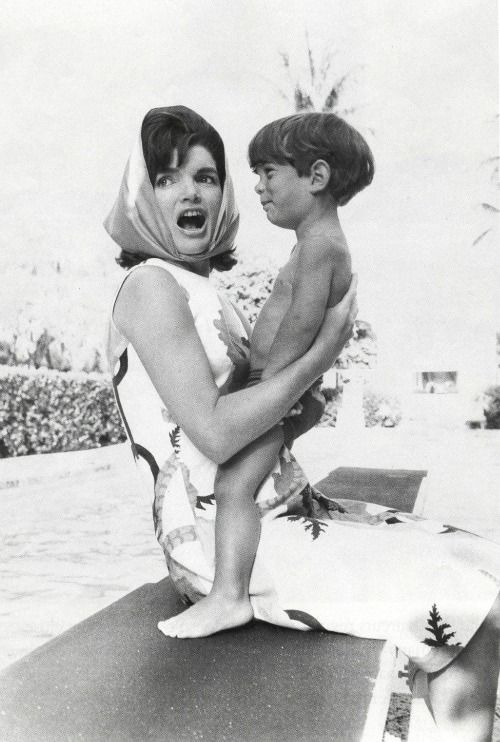 Jackie  John Kennedy I love the way she holds him.....her loving hand spread across his back, palm open...