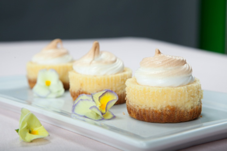 Individual lemon meringue cheesecakes.