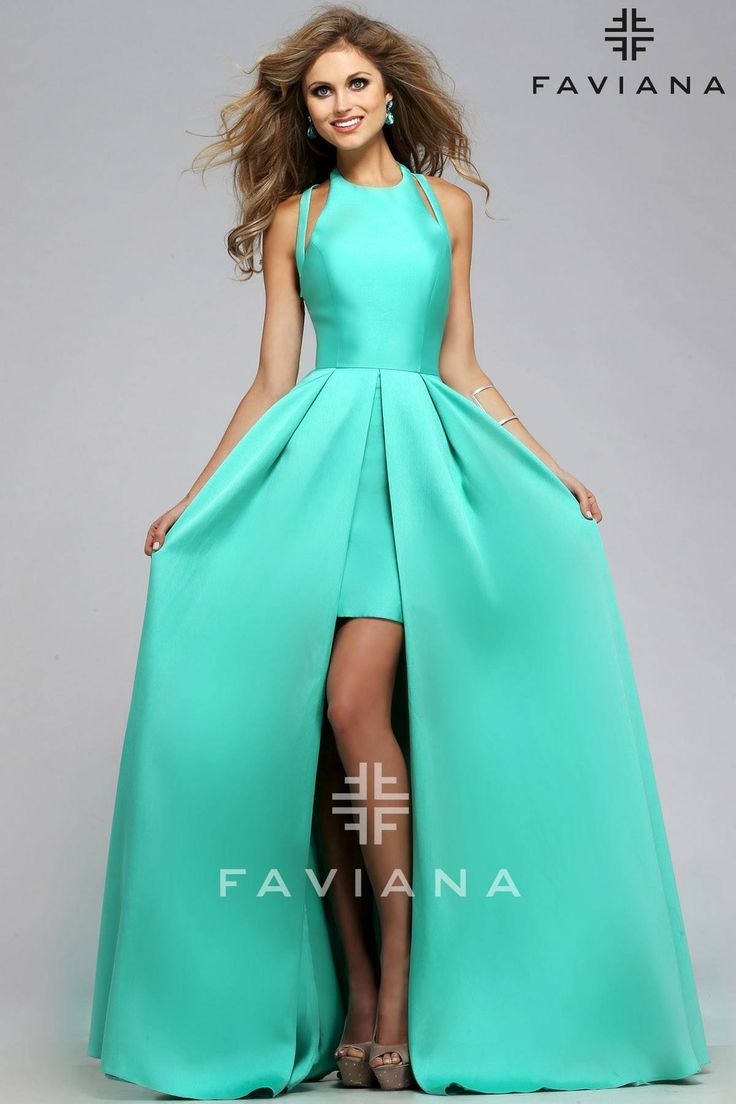 The Taylor Swift dress everybody's talking about. It has a short satin skirt with a long pleated overskirt and a cute halter bodice with crossed back straps View Size Chart