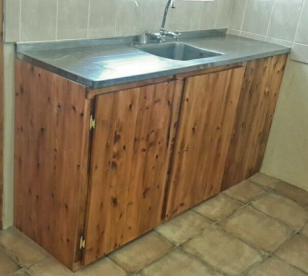 Kitchen cupboard made from reclaimed floorboards