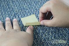 How to remove adhesive tape residue from carpet